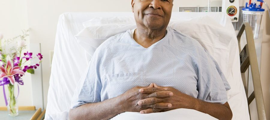 bigstock-Senior-Man-Sitting-In-Hospital-13886003